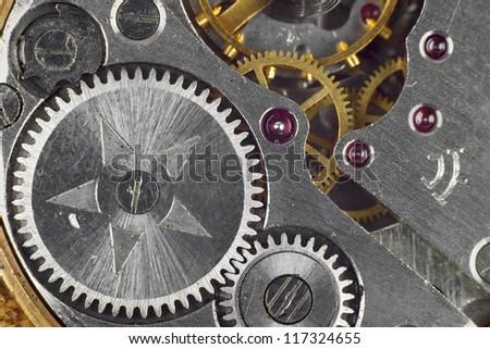 Clockwork details, pinions and wheels macro closeup wallpaper - stock photo