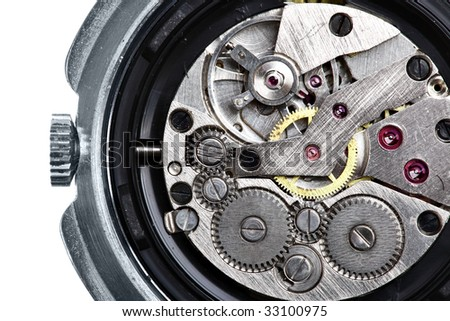 Clockwork of wristwatch isolated over white background - stock photo