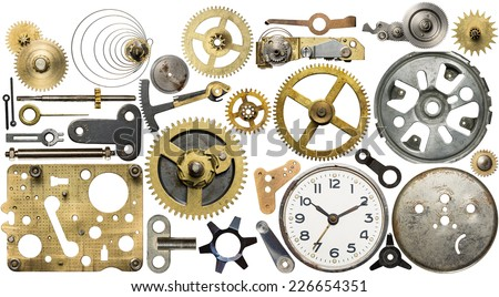 Clockwork spare parts. Metal gear, cogwheels, dial. - stock photo