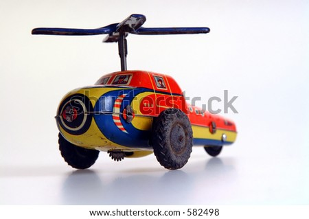 Clockwork tin toy helicopter. - stock photo