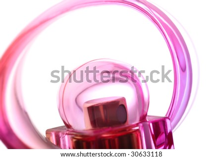 Close abstract detail of red and pink female perfume flacon on white - stock photo