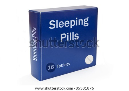 "Close and low level angle capturing a blue medication pack with the words ""Sleeping Pills"" arranged over white."
