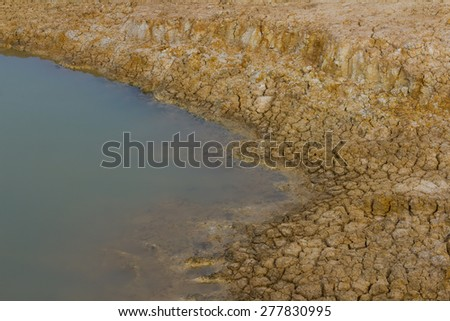 Close background soil surface dry above the water surface of the pond farmers. - stock photo