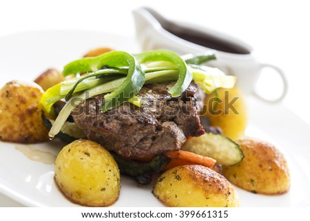 close beef with potatoes and sauce