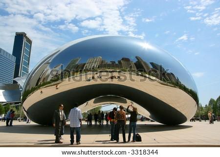 "Close central view of Cloud Gate sculpture aka ""The bean"", Millennium Park, Chicago, Illinois - stock photo"