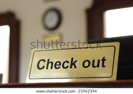 Close check out tablet on reception desk - stock photo