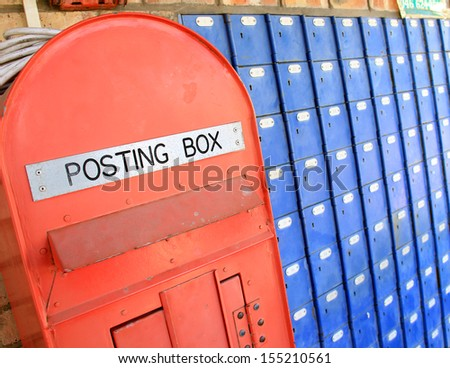 Close crop image of brightly coloured blue and red post boxes. - stock photo