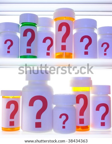 Close crop of medicine cabinet shelves filled with pill bottles, each labeled with a red question mark.  Bottles and shelves are  lit with cooler blue light and are strongly backlit with white light. - stock photo
