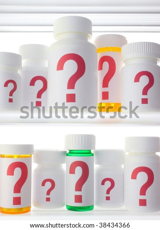 Close crop of medicine cabinet shelves filled with pill bottles, each labeled with a red question mark.  Lighting is neutral with strong back lighting. - stock photo