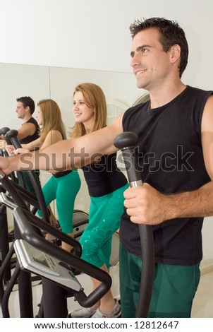 Close cropped shot of a young, attractive couple working out at the gym together - stock photo