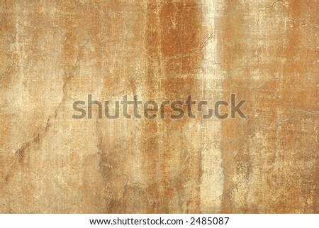 close detail of beautifully textured ochre stucco weathered by time wall background - stock photo