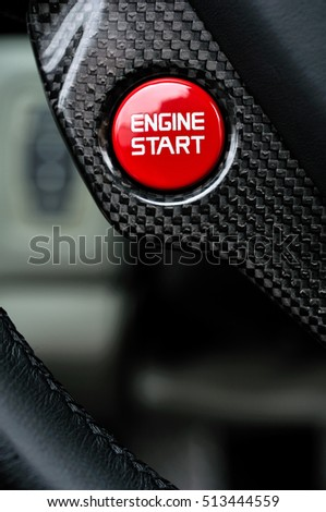 Close Detail of the start stop button in a luxury Performance Car