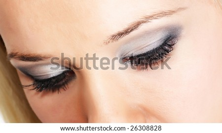 Close female eye with silver-gray cosmetic make-up