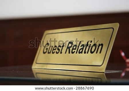 Close Guest relation tablet on reception desk - stock photo