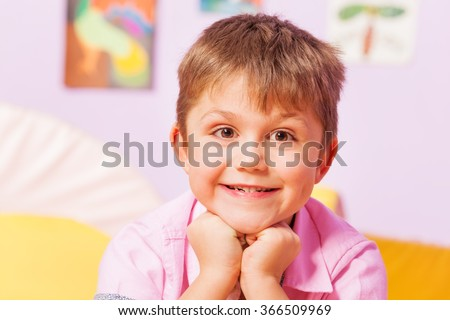 Close happy portrait of a boy smiling - stock photo