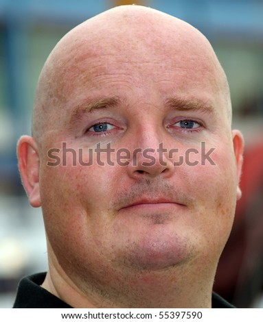 close head shot of a male in his 30's - stock photo