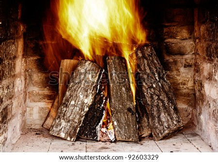 Close image of fire in the fireplace - stock photo