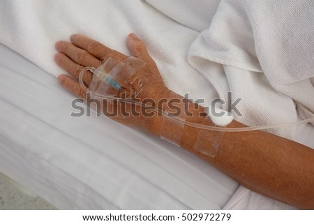 Close image of iv cannula(catheter) on left hand.