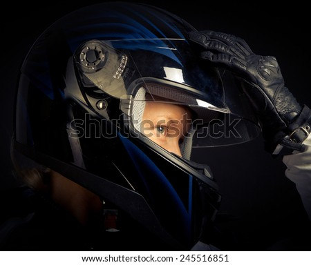 Close image of motorcyclist - stock photo