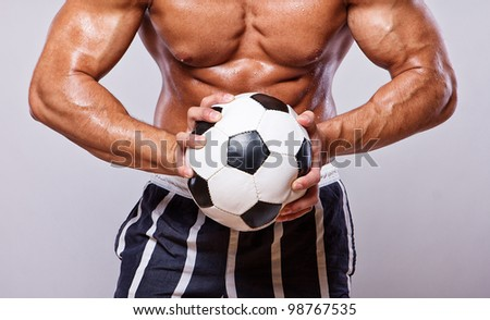 Close image of muscle man with ball