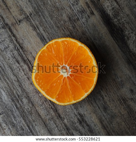 Close image of orange slice placed on kitchen counter-top