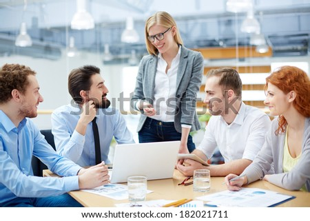 Close-knit business team approving his colleague�¢??s idea about company�¢??s development  - stock photo