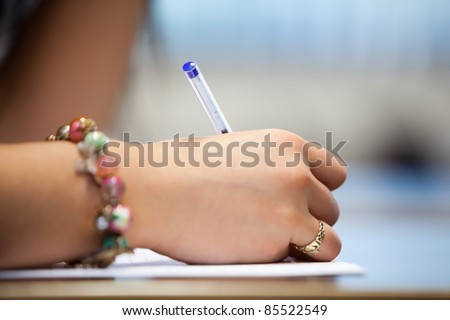 Close of a hand writing on a paper - stock photo