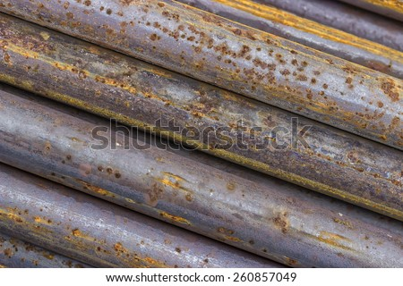 Close of rusty iron rods used to reinforce concrete. Steel bars background. - stock photo