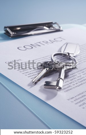 close of the key on the contract form - stock photo