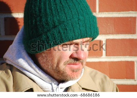 close of unemployed middle age homeless man - stock photo