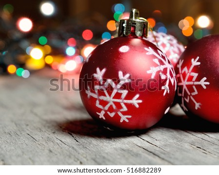 close on christmas balls with colorful lights background