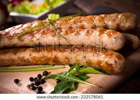 Close p to grilled sausages on wooden board,selective focus  - stock photo
