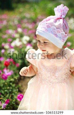 Close portrait little child in flowers field