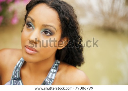 Close portrait of a beautiful woman with proffesional makeup - stock photo
