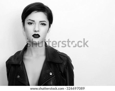 close portrait of beautiful brunet woman in grunge style with black lips. copy space.