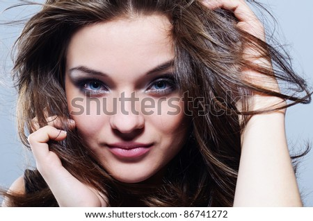 Close portrait of beautiful girl with fluttering hair. - stock photo