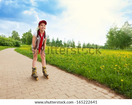 Close portrait of brunet happy little 10 years old girl scatting in the park - stock photo