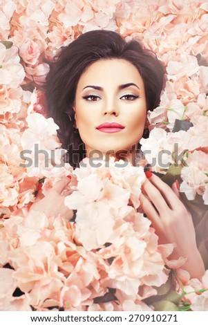 Close portrait of brunette girl. Face colors. - stock photo