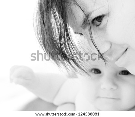Close portrait of mother and baby - stock photo
