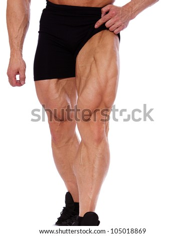 Close portrait of muscle man legs - stock photo