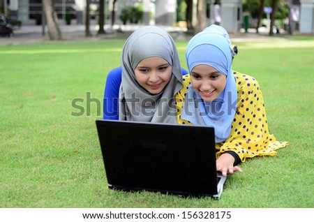 Close portrait of pretty young Asian students  - stock photo