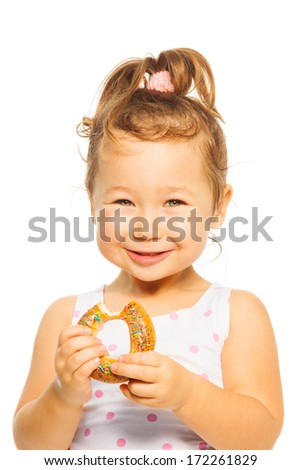 Close portrait of smiling Asian girl with donut  - stock photo