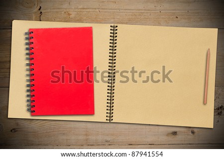 Close Red Notebook, Vintage SketchBook with Pencil on Old Wooden Table