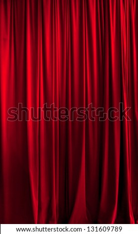 Close red theater curtain ideal for backgrounds - stock photo