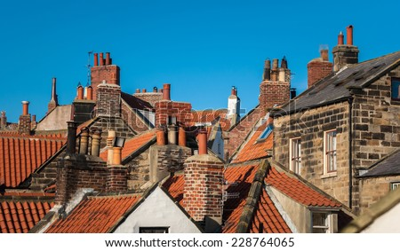 Close rooftops of the fishing village of Robin Hood's Bay in North Yorkshire. - stock photo
