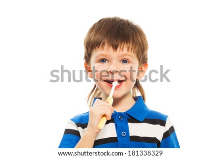 Close shoot of thee years old boy brushing his teeth with toothbrush isolated on white - stock photo