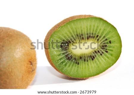 Close shot of a kiwifruit cut in half - stock photo