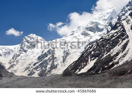 close shot of mountain with glacier and moraines