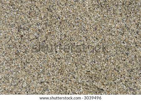 Close shot of sea sand. Suitable for background texture. - stock photo