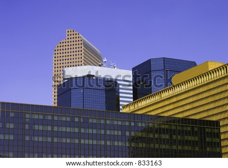 Close shot of some of Denver's skyline with a beautiful blue background showing intersection of several geometrical angles from 6 buildings. - stock photo